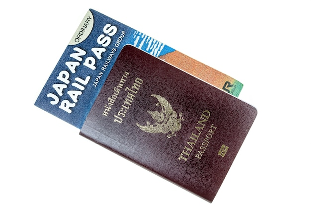 Паспорт, деньги и железнодорожный перевал на белом фоне.