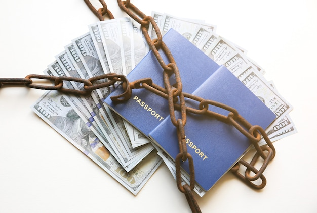 Passport and money in old rusty chains. arrested for illegal immigration. broken the law. smuggling concept.