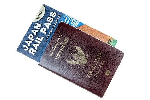 Passport, money and rail pass on white background.