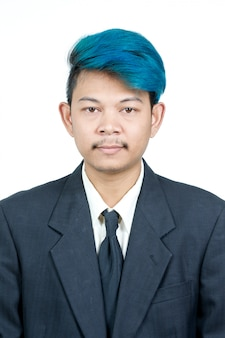 Passport photo of young attractive asian man with blue hair in suit isolated