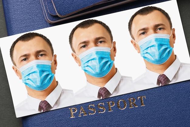 의료 마스크에 남자의 여권 사진