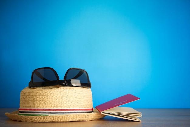 Passport sunglasses sunglasses on a wooden table prepare to travel abroad.