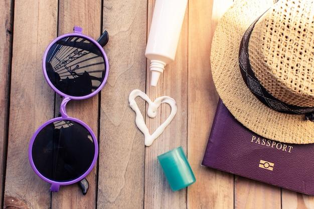 Passport with hat and sun block cream for travel adventure