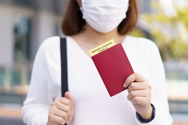 Passport with vaccination certificate for covid-19 person record card. immune passport or certificate for get vaccinated before travel. vaccination, disease immunity passport