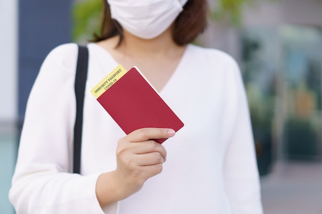 Passport with vaccination certificate for covid19 person record card immune passport or certificate