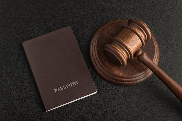 Passports and judge gavel on gray black.