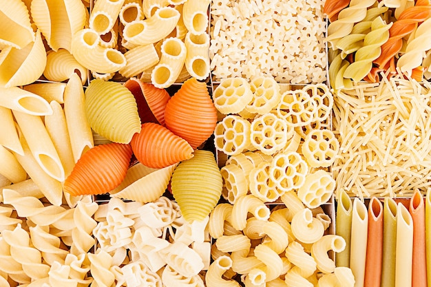 Pasta background assortment of different kinds italian macaroni in chess cells