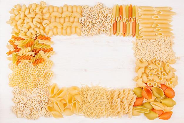 Pasta background decorative frame of assortment different kinds italian macaroni