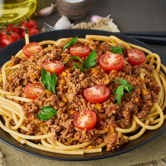 Pasta bolognese bucatini with mincemeat and tomatoes