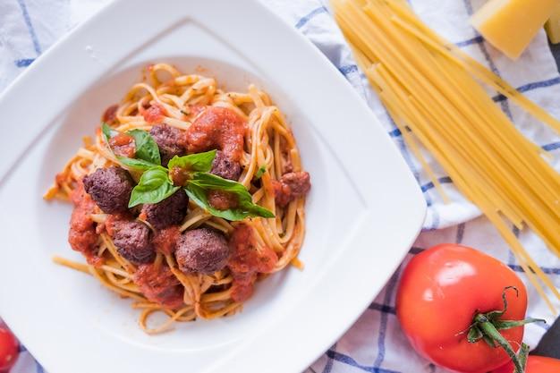 Pasta bolognese on white plate. spaghetti on blue background