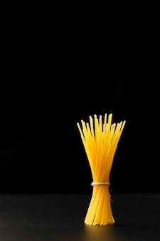 Pasta bond on a dark background