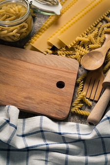 Pasta collection on rustic wooden background