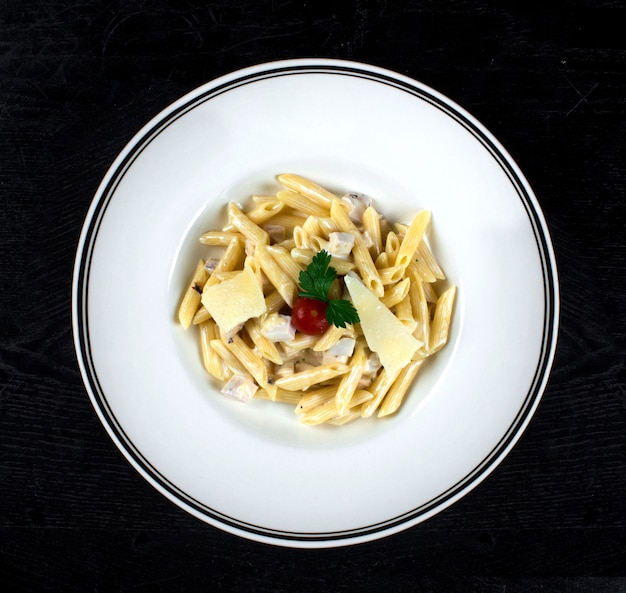 Pasta in cream sauce with chicken and parmesan
