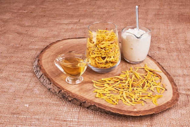 Pasta in a cup with ingredients around.