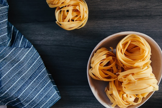 Pasta dish with a handful of raw tagliatelle