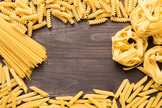 Pasta frame collection on rustic wooden background