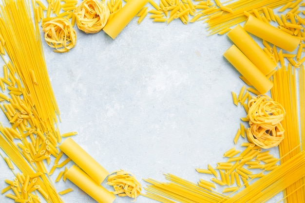 Pasta frame on textured background