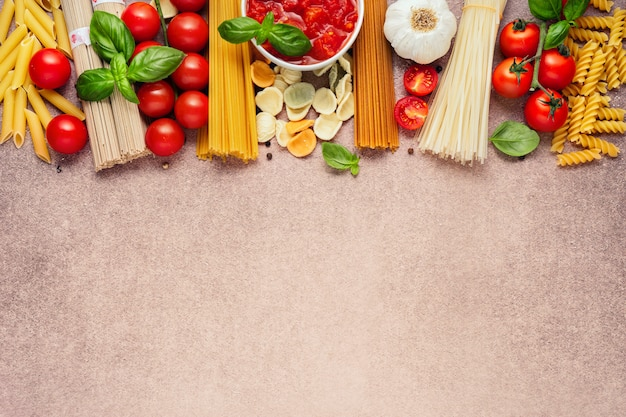 Pasta ingredients on light rustic background
