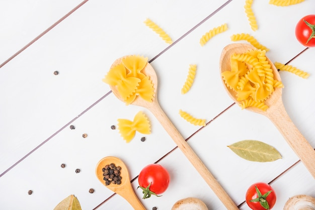 Pasta ingredients on white wooden table