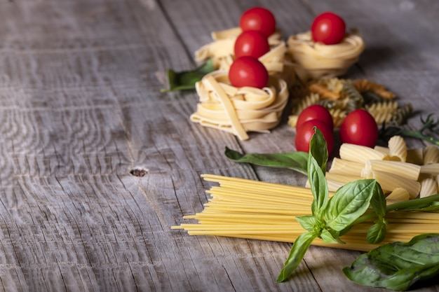 Pasta ingredients on a wooden surface