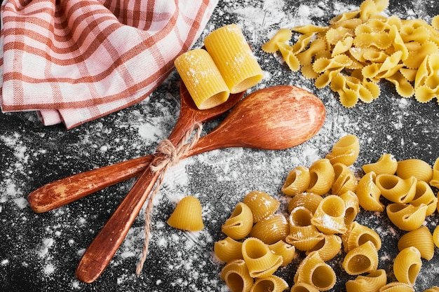 Pasta isolated on black covered with flour.
