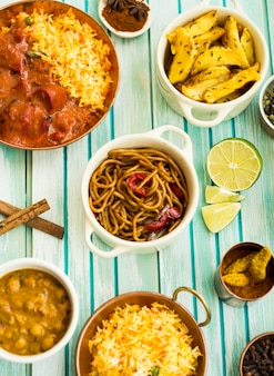 Pasta and lime amidst spices and dishes