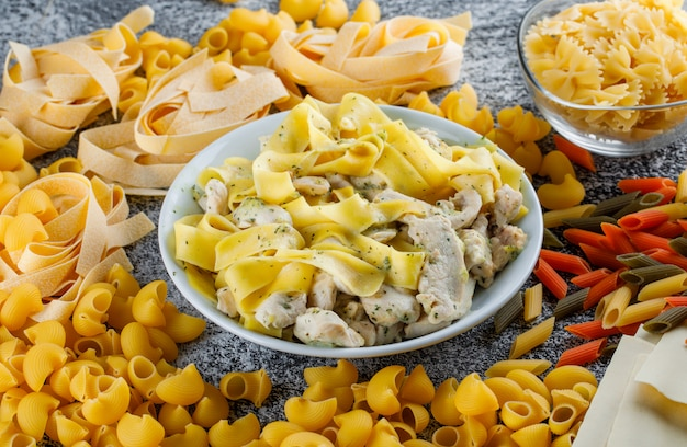 Pasta and meat with dough, raw pasta in a plate