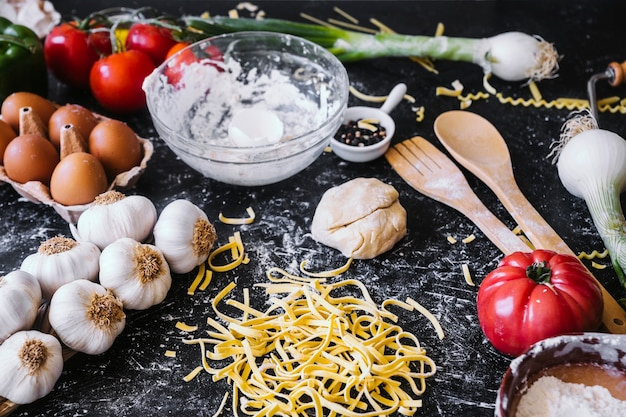 Pasta near assorted ingredients on kitchen table