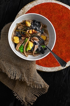 Pasta pizzoccheri with chinese cabbage, potato on dark background. italian traditional dish