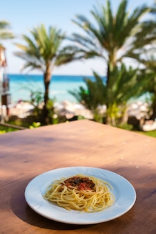 Pasta plate on with sea views. the concept of relaxing.