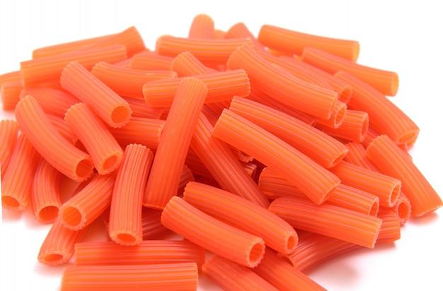 Pasta red macaroni (tomatoes) on white background