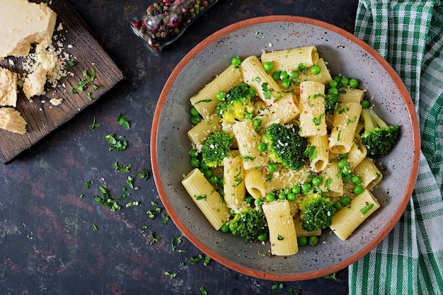 Pasta rigatoni with broccoli and green peas. vegan menu.