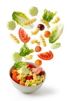 Pasta salad flying in bold, healthy food,