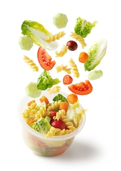 Pasta salad flying from container