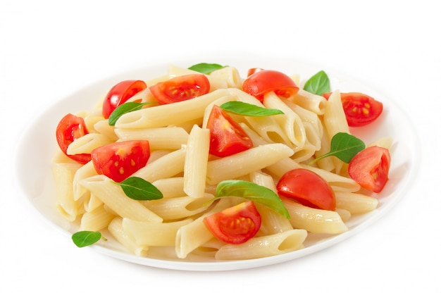 Pasta salad with cherry tomatoes and fresh basil leaves