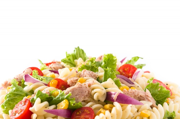 Pasta salad with vegetables isolated on white close up