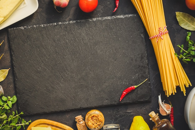 Pasta, spaghetti or bucatini and tomato sauce ingredients. food background. copy space