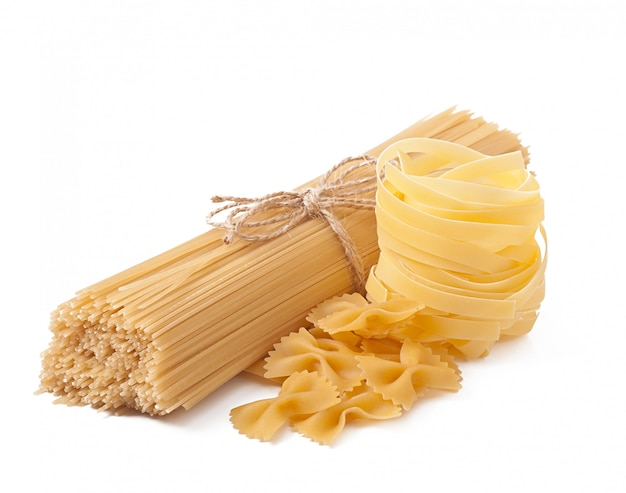 Pasta spaghetti, vegetables, spices isolated on white