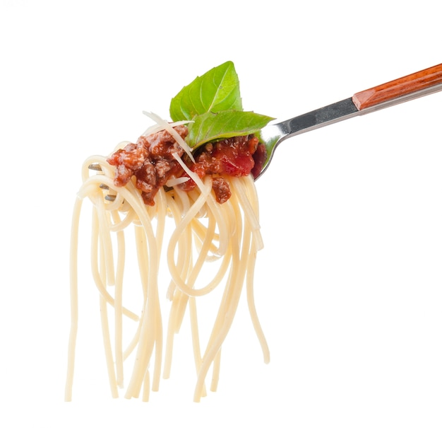 Pasta spaghetti with bolognese sauce on a fork