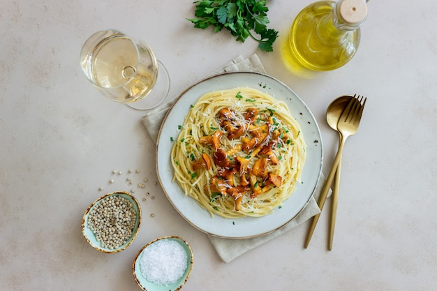 Pasta spaghetti with mushrooms chanterelle and parmesan cheese. healthy eating. vegetarian food. italian food.