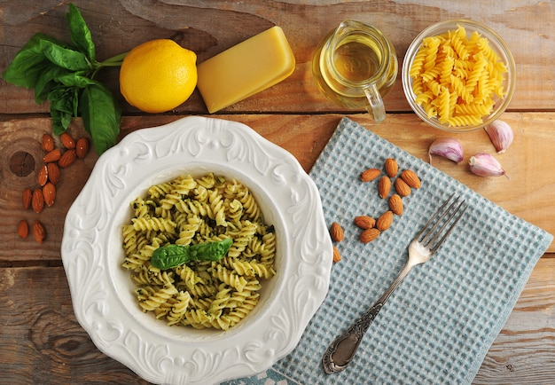 Pasta spirals with cheese, almonds and basil