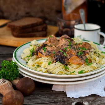 Pasta with beef meatballs and wild mushrooms
