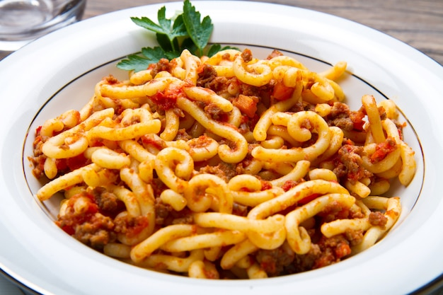 Pasta with bolognaise sauce and herbs