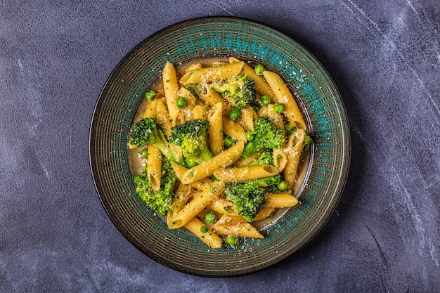 Pasta with broccoli, green peas, garlic, cheese