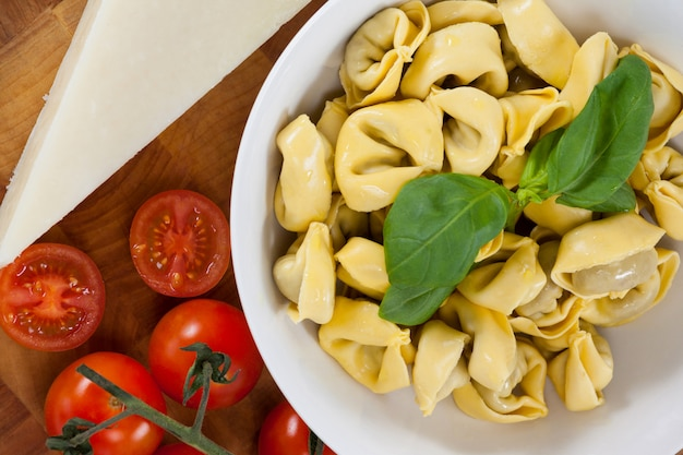Pasta with herbs, cheese, tomatoes and napkin cloth