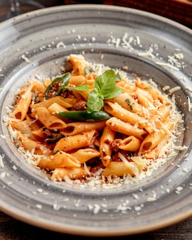 Pasta with meat grated cheese and basil leaf