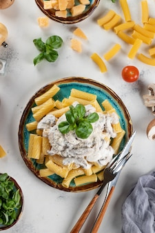 Pasta with mushroom sauce and basil and hard cheese