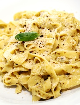 Pasta with parmesan cheese and basil leaf