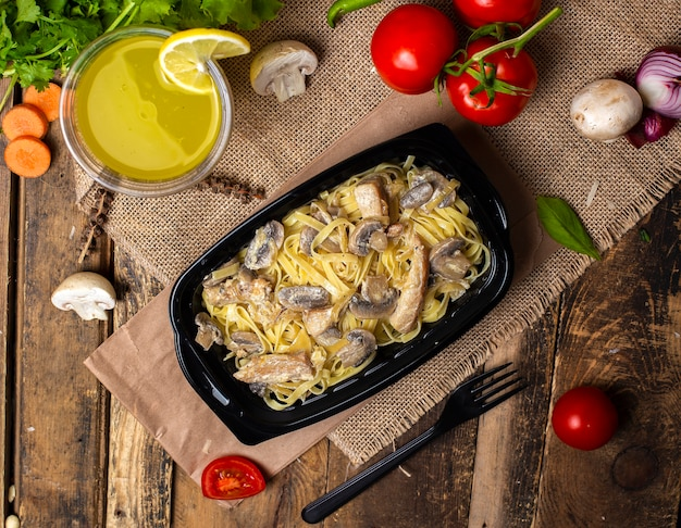 Pasta with sauteed mushroom with chicken in cream butter sauce takeaway