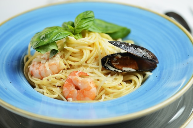 Pasta with shrimp, mussels, cheese and basil